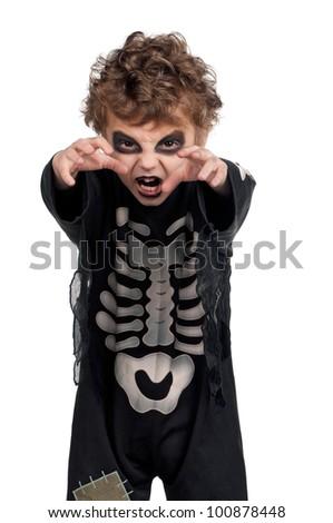 Portrait of little boy wearing halloween costume on white background - stock photo