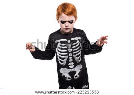 Portrait of little boy wearing halloween costume. Studio portrait isolated over white background - stock photo