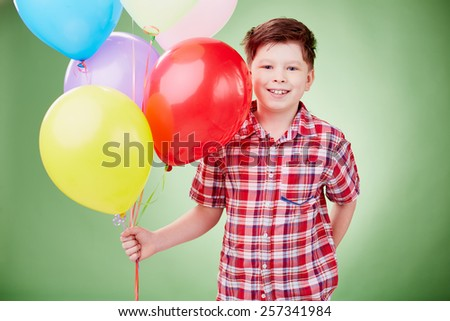 Portrait of little boy with balloons - stock photo