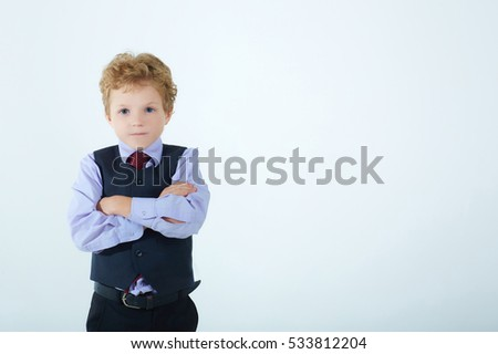 Portrait of little boy with crossed hands isolated on white background.