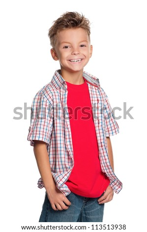 Portrait of little boy with hands in pockets isolated on white background - stock photo