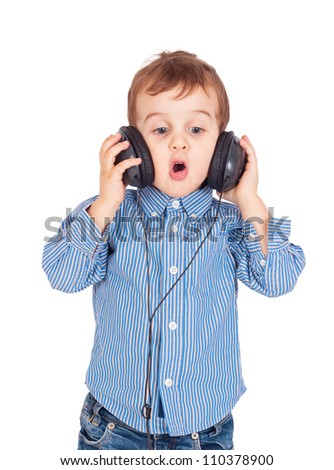 Portrait of little boy with headphones and singing. Isolated on white background. Clipping paths included. - stock photo