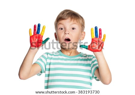 Portrait of little boy with paints on hands isolated on white background - stock photo