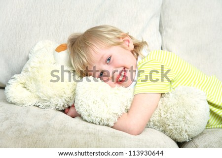 Portrait of little boy with teddy bear at home - stock photo