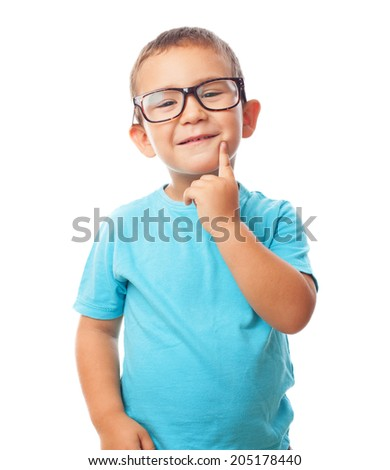 portrait of little boy with thinking gesture - stock photo