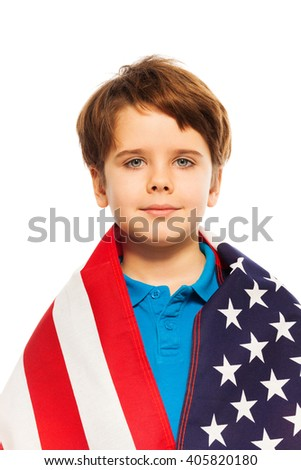 Portrait of little boy wrapped in the USA flag - stock photo