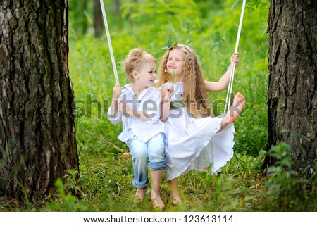 portrait of little boys and girls outdoors in summer - stock photo
