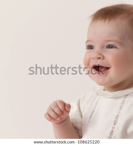 portrait of little child baby girl studio shot face smiling cheerful