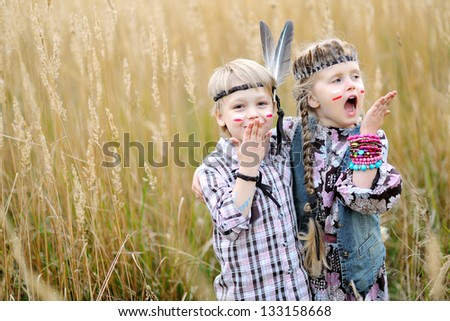 Portrait of little children dressed as Indians - stock photo