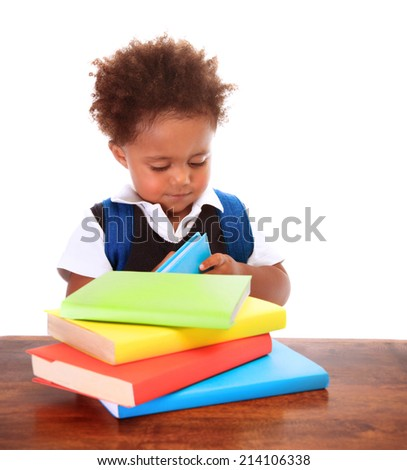 Portrait of little clever boy isolated on white background, cute african schoolboy reading book, back to school concept - stock photo
