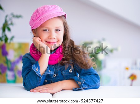 portrait of  little cute fashion  girl