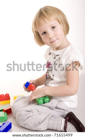 portrait of little cute girl playing isolated on white background