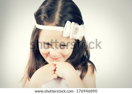 Portrait of little cute girl who prays or dreams - stock photo