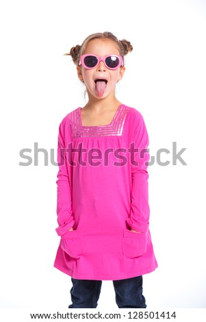 Portrait of little fashion girl in pink dress and sunglasses. Isolated white backround. - stock photo