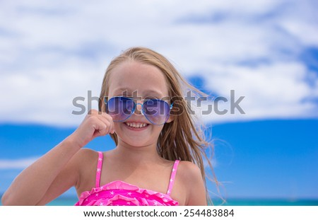 Portrait of little girl at tropical beach during vacation