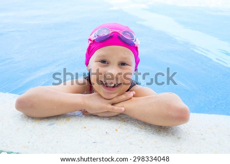 portrait of  little girl by the side of the pool - stock photo