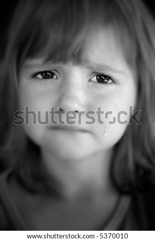 Portrait of little girl crying with tears rolling down her cheeks - stock photo