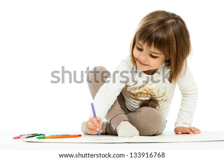 Portrait of little girl drawing with wax crayons.isolated on white. - stock photo