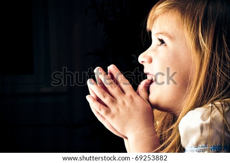 Portrait of little girl dreaming about something and playing - stock photo