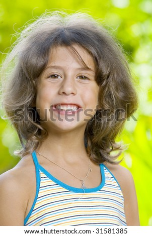 Portrait of little girl having good time in summer environment