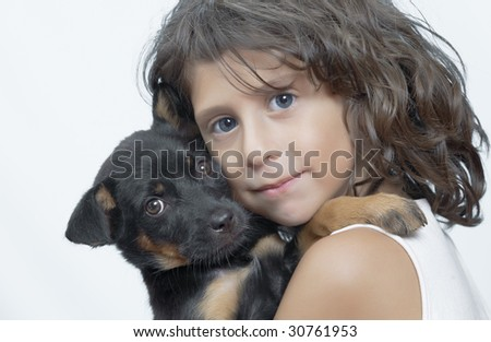Portrait of little girl having good time with her puppy