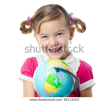 portrait of little girl holding a globe looking at camera with toothy smile isolated on white studio shot - stock photo