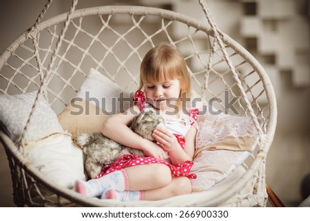 Portrait of little girl holding favorite toy - stock photo