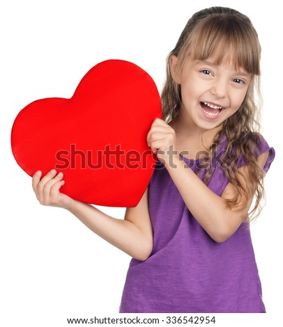 Portrait of little girl holding red heart over white background - stock photo