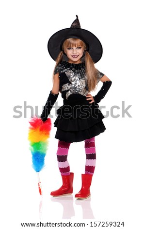 Portrait of little girl in black hat with soft colorful duster isolated on white background - stock photo