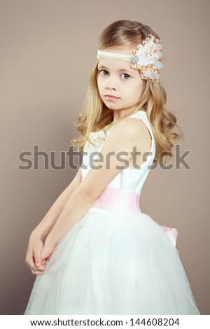 Portrait of little girl in luxurious dress. Fashion photo - stock photo