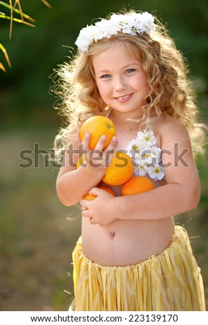 portrait of little girl in tropical style - stock photo