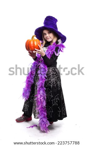 Portrait of little girl in witch costume with pumpkin. Halloween character. Studio portrait isolated over white background   - stock photo