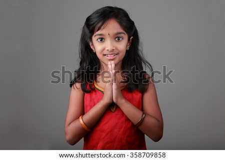 Portrait of little girl of Indian origin with folded hands - stock photo