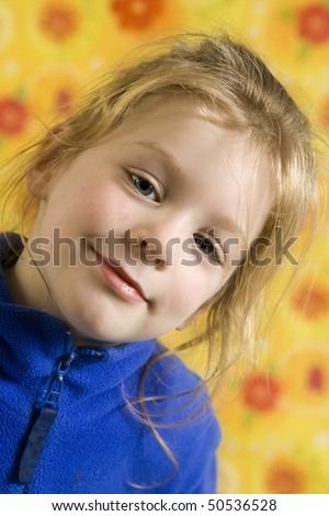 Portrait of little girl on a yellow floral backgound - stock photo