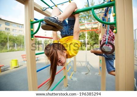 Portrait of little girl on playground area - stock photo