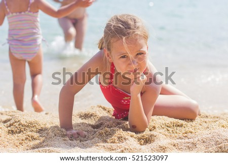 Portrait of Little Girl on the sand beach. Summer vacation.
