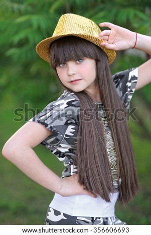 portrait of little girl outdoors in summer