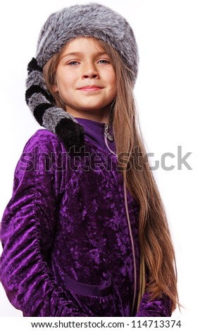 Portrait of little girl posing in studio in hat