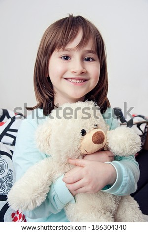 Portrait of little girl smiling with teddy bear