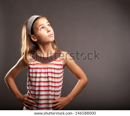 portrait of little girl thinking - stock photo