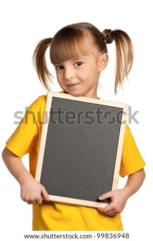 Portrait of little girl with blackboard isolated on white background - stock photo
