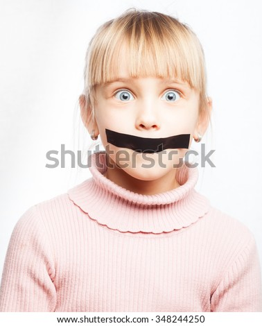 Portrait of little girl with duct tape on her mouth - silenced child concept - stock photo