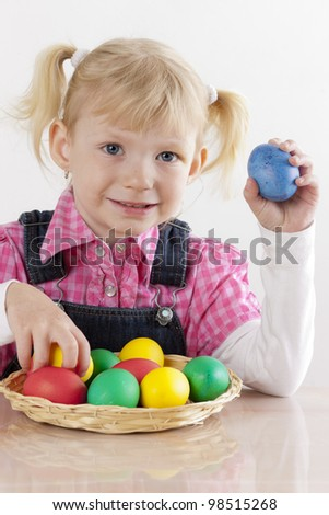 portrait of little girl with Easter eggs