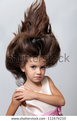 portrait of little girl with extravagant hair on his head - stock photo