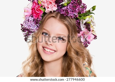 Portrait of little girl with flower wreath