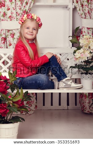 Portrait of little girl with flower wreath indoor