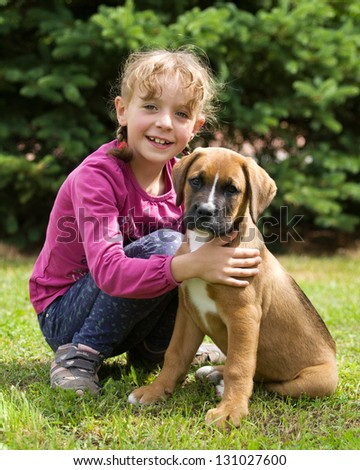 Portrait of little girl with her dog