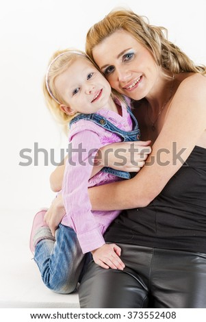 portrait of little girl with her mother - stock photo