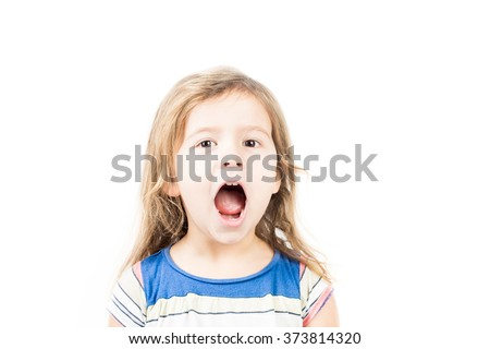 Portrait of little girl with mouth open - stock photo