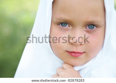 Portrait of little girl with red backpack and books - stock photo